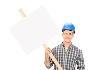Smiling male construction worker in uniform and helmet holding a