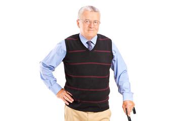 Smiling senior gentleman with cane posing