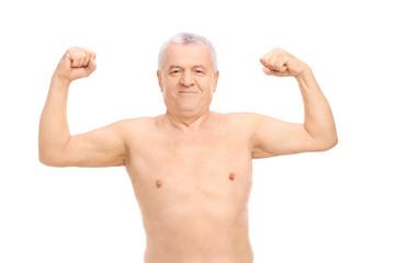 Smiling senior man in underwear showing his biceps