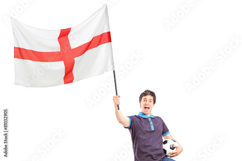 Euphoric young football fan holding an English flag and football