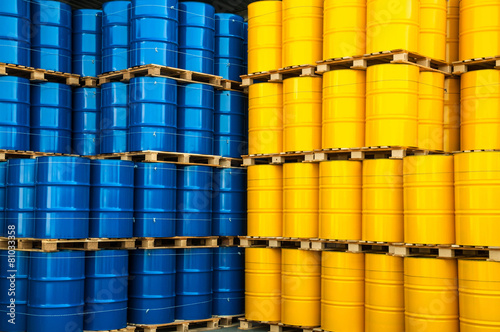 Leinwanddruck Bild Blue and yellow oil drums