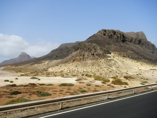 Tarmac road in desert with mountains