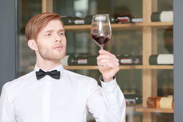 Sommelier testing red wine