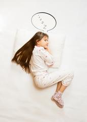 cute girl sleeping on big cushion with speech bubble