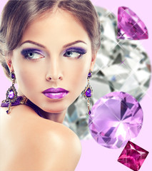 girl with lilac makeup . Fashion jewelry  precious stones