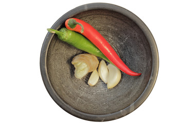 Ginger, garlic and chilies in a mortar, view from above