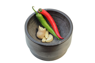 Ginger, garlic and chilies in a mortar, isolated on white