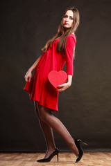 Woman holding heart shaped gift box