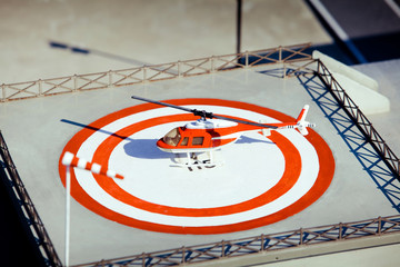 Helicopter on heliport