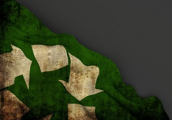 Recycle symbol 3d corner flag overlaid with grunge texture