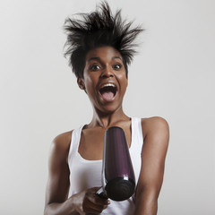 screaming fun girl with a hair dryer