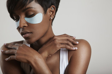 pretty woman with a eye treatment patches