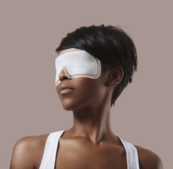woman with an eye mask, making an eye treatment and lines spread