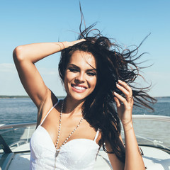 happy  woman smiling have fun on the luxury boat