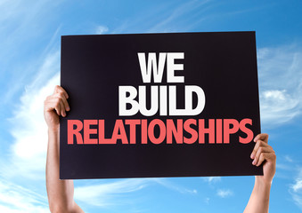We Build Relationships card with sky background