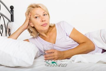 mature woman  taking medicine