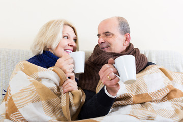 Couple warming up with tea