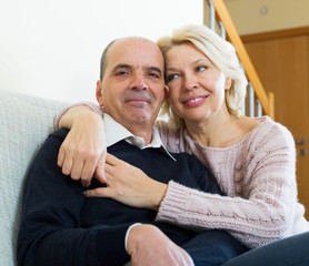 Couple pensioners together on sofa at home