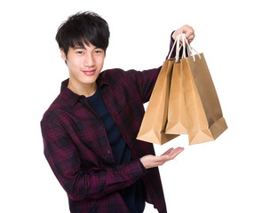 Young man carrying shopping bag