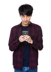 Young asian man texting message