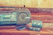 Leinwanddruck Bild - old cassette tape and player ,vintage style