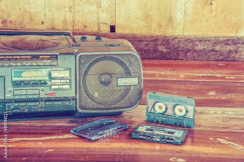 Leinwanddruck Bild old cassette tape and player ,vintage style