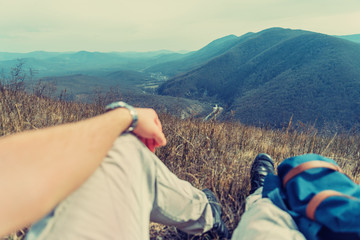 Traveler man resting in the mountains