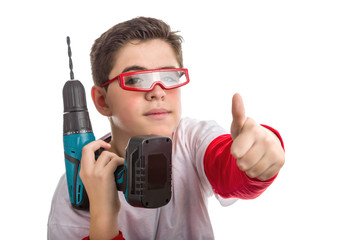 Caucasian smooth-skinned boy wearing red goggles and holding a c