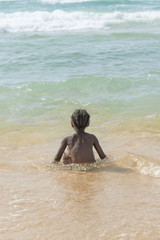 Afro girl at the beach, six years old