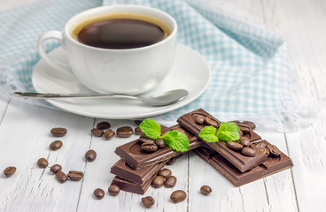 Dark chocolate with a cup of coffee