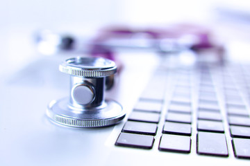 Violet stethoscope on a laptop computer