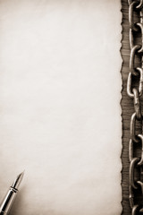 metal chain and old paper