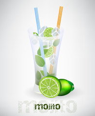 Glass of mojito and drinking strew with lime and ice cubes