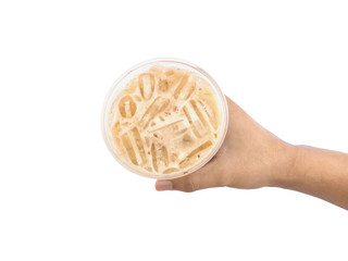 Hand holding glass of iced coffee