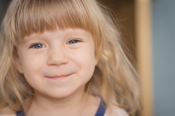 Close-up portrait of adorable smiling little girl.