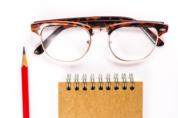 Notebook with Glasses and pencil isolated on white background