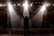 Leinwanddruck Bild - Silhouette of actors in the spotlight
