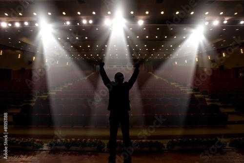 Leinwanddruck Bild Silhouette of actors in the spotlight
