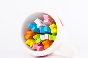 Group colorful pastel of wooden clothespins in coffee cup  isola