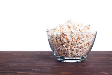 popcorn in a pot on the table isolated on white background