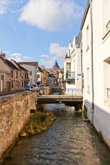 Voulzie river and medieval street in Provins, France