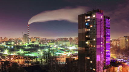Smoke from the industrial pipe in the city at night, Real time