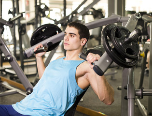 Young man training pectoral muscle