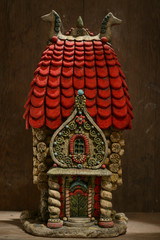 Ceramic statue of a little old Russian house
