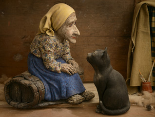 Ceramic artist grandmother with a cat