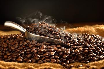 Coffee beans with smoke on burlap © amenic181