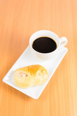 black coffee and bread ,coffee break on wooden background
