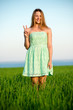 Happy vitality freedom girl stands with her hands. Playfull