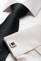 White men shirt with a black tie