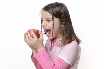 Young Girl Eating an Apple With Her New Permanent Teeth